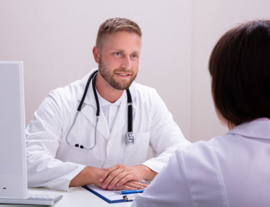 medical consultant on a session with his patient