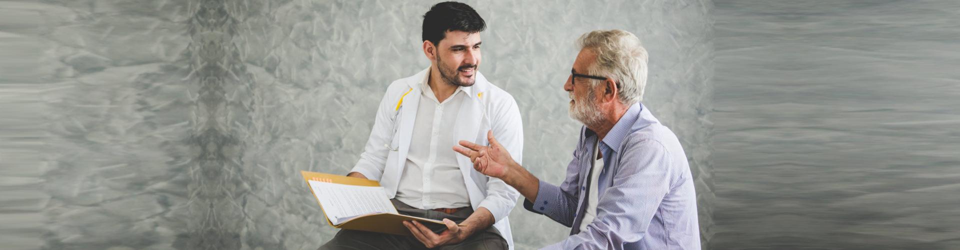 a staff talking with an elderly men