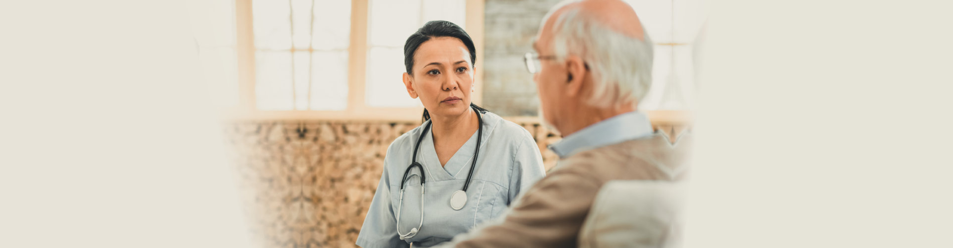 a medical consultant listening to her patient